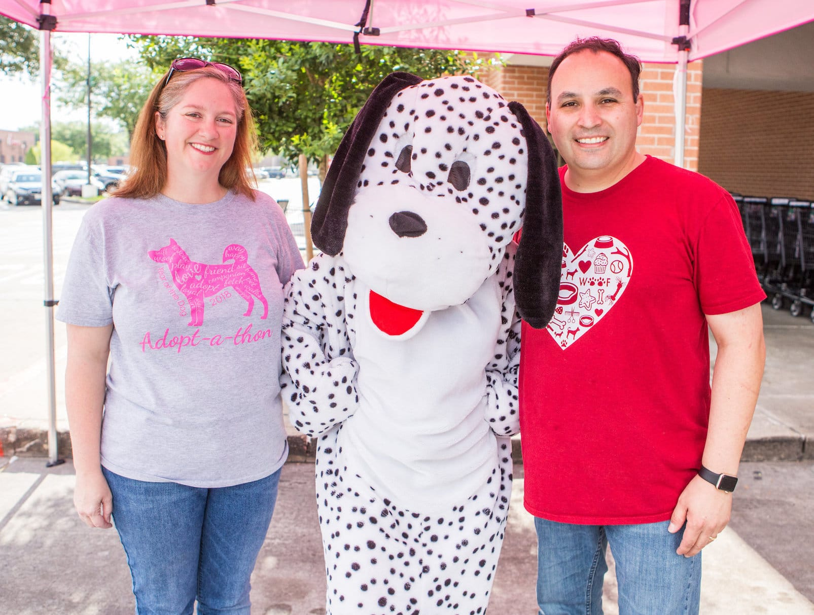 Woof Gang Bakery franchisees with mascot